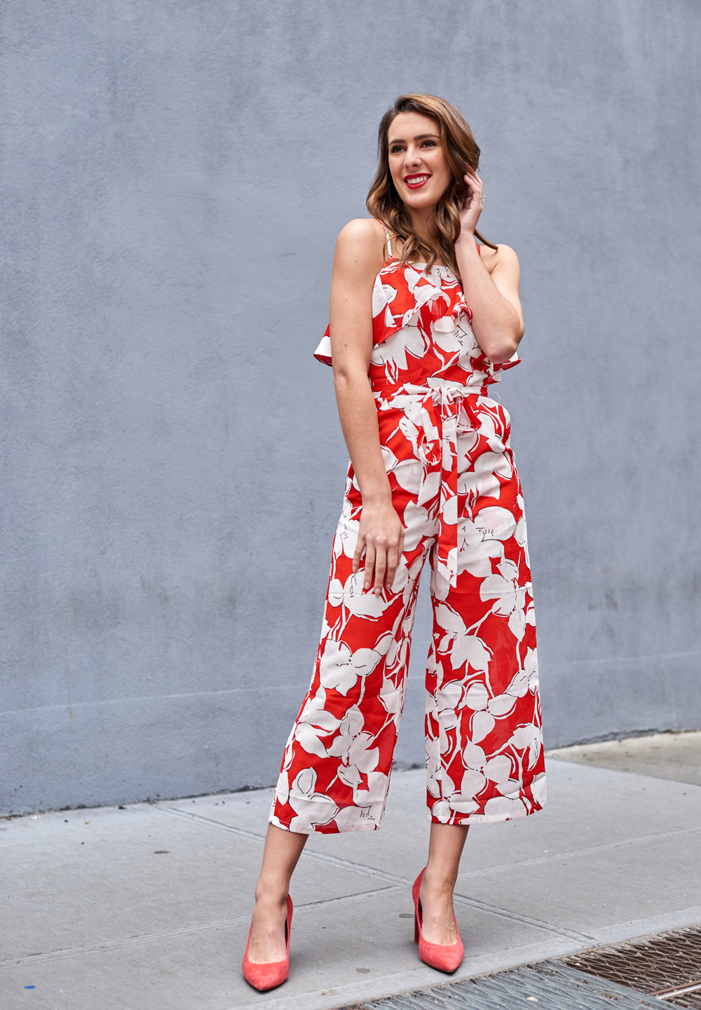 Samantha Metll of Bonjour Blue wearing a red floral print jumpsuit