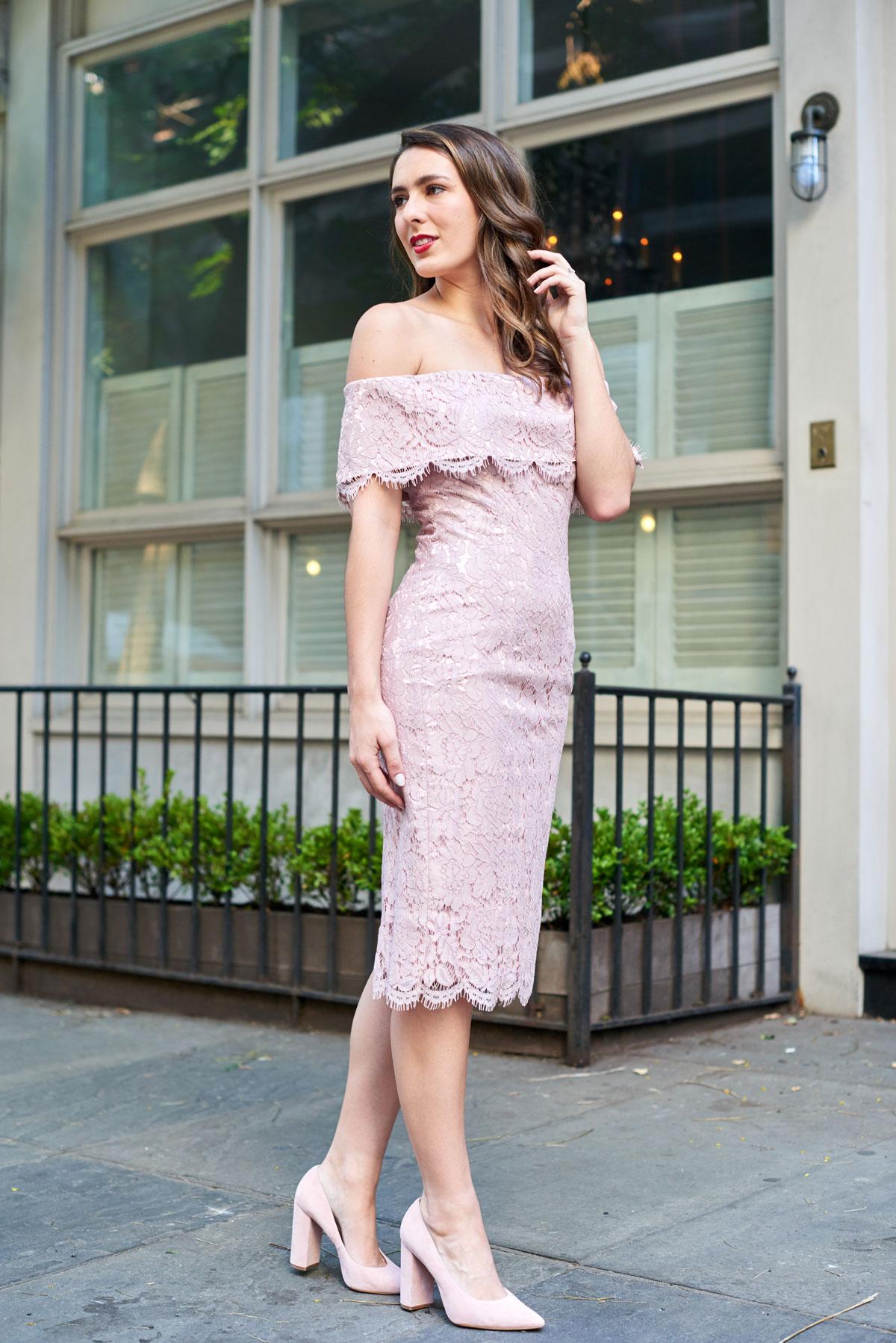 Samantha Metell of Bonjour Blue wearing a blush pink lace dress